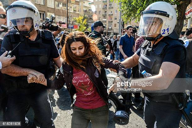 Turkish antiriot police officers detain a protester on October 26 2016 during a demonstration against the detention of the Kurdishmajority city's...