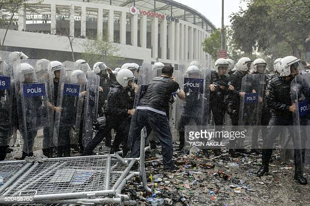Turkish antiriot police use tear gas and water cannon to disperse supporters around the stadium before the Turkish Spor Toto Super league football...
