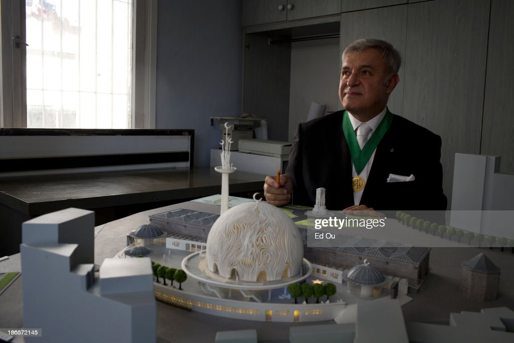 Turkish architect Ahmet Vefik Alp sits over a model of a mosque in his office which he designed to be built in Taksim Square in Istanbul Turkey on...