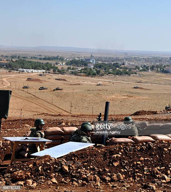 Turkish Armed Forces soldiers are seen on the hills at the Turkey Syria boder in Sanliurfa Turkey as the clashes between the Islamic State of Iraq...