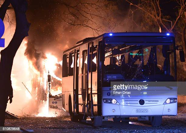 Turkish army busses burn after an explosion on February 17 2016 in Ankara Turkey According to Ankara Governor Mehmet Kiliclar at least 18 people have...