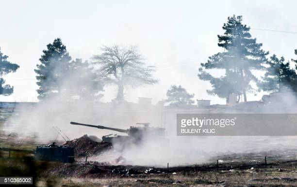 TOPSHOT Turkish army cannon shoots in the Syrian direction near Syria border close to Oncupinar crossing gate in Kilis in southcentral Turkey on...