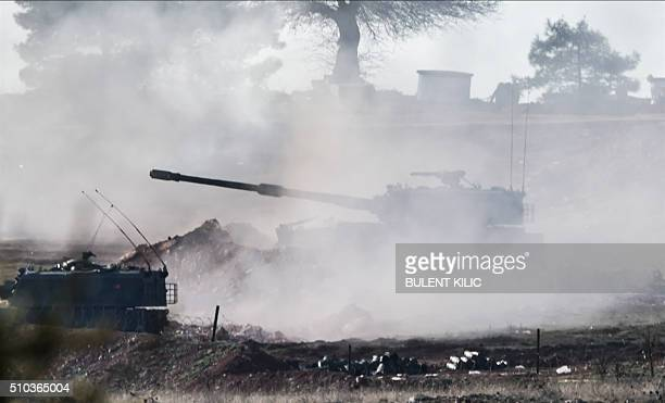 Turkish army cannon shoots in the Syrian direction near Syria border close to Oncupinar crossing gate in Kilis in southcentral Turkey on February 15...
