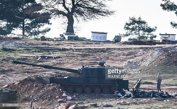 Turkish army cannons are pictured near Syria border close to Oncupinar crossing gate in Kilis in southcentral Turkey on February 15 2016 / AFP /...