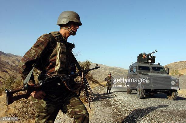 Turkish army commandos seach for roadside mines on patrol at the area near the TurkeyIraq border on October 27 2007 in the Uludere district of Sirnak...