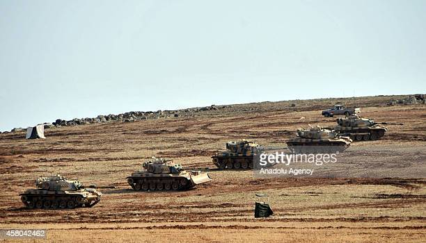 Turkish Army Forces take security measure at the border in Suruc district of Turkey's Sanliurfa during the clashes between Islamic State of Iraq and...
