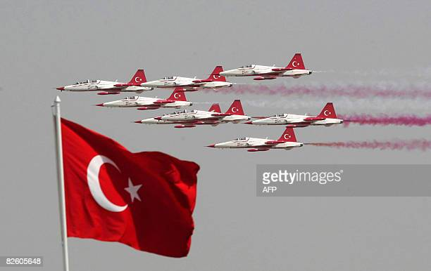 Turkish Army jets perform in front a Turkish flag during Victory Day celebrations in Ankara on August 30 2008 AFP PHOTO / ADEM ALTAN