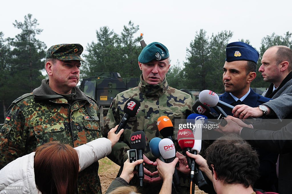 Turkish army major Cengiz Alabacak (R), NATO spokesman Darius Kacpencyzk (C) and German Patriots team commander Frank Schultz (L) speak to the media at a Turkish military base in Kahramanmaras on January 31, 2013. A second pair of Patriot missile batteries being sent by NATO countries to defend Turkey against possible attack from Syria are now operational, a German security official said on January 29. The United States, Germany and the Netherlands each committed to sending two batteries and up to 400 soldiers to operate them after Ankara asked for help to bolster its air defences against possible missile attack from Syria. The two German batteries, which have been deployed around the Turkish city of Kahramanmaras some 100 km (60 miles) from the Syrian border, were in position and ready to use, the German security official said.