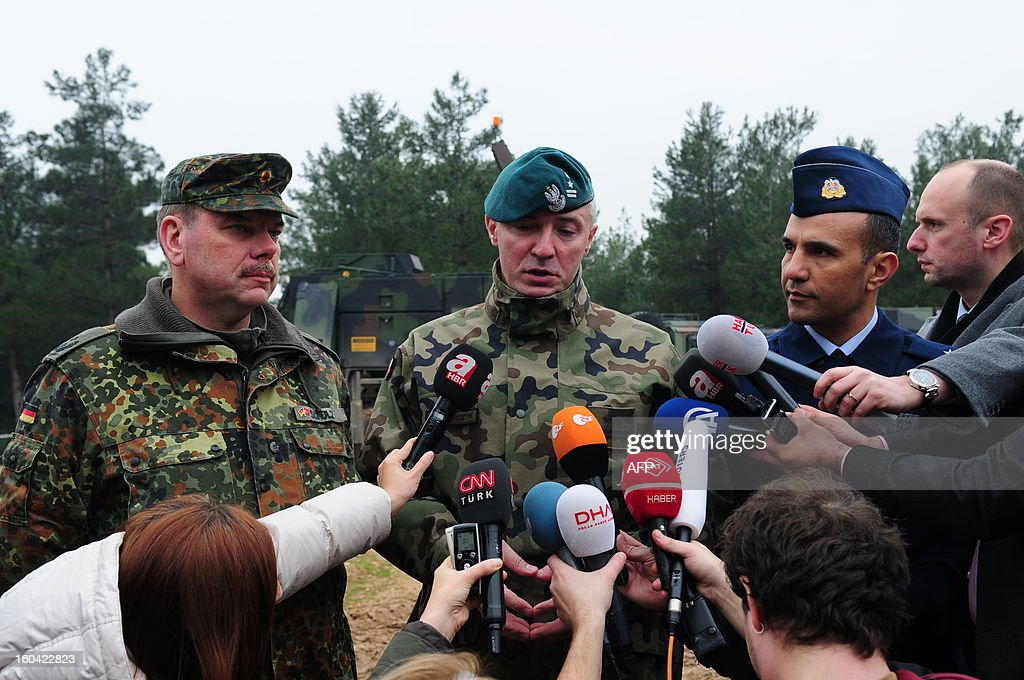 Turkish army major Cengiz Alabacak (R), NATO spokesman Darius Kacpencyzk (C) and German Patriots team commander Frank Schultz (L) speak to the media at a Turkish military base in Kahramanmaras on January 31, 2013. A second pair of Patriot missile batteries being sent by NATO countries to defend Turkey against possible attack from Syria are now operational, a German security official said on January 29. The United States, Germany and the Netherlands each committed to sending two batteries and up to 400 soldiers to operate them after Ankara asked for help to bolster its air defences against possible missile attack from Syria. The two German batteries, which have been deployed around the Turkish city of Kahramanmaras some 100 km (60 miles) from the Syrian border, were in position and ready to use, the German security official said. AFP PHOTO/STR