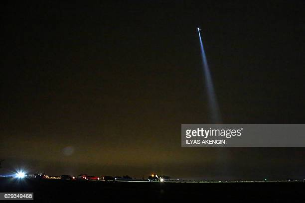 A Turkish army rescue helicoper flies over a field where a Turkish F16 war plane crashed on December 12 2016 in the southeastern city of Diyarbakir A...