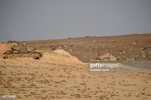Turkish army tanks hold their position on top of a hill near Mursitpinar border crossing on the TurkishSyrian border October 24 2014 The Syrian town...
