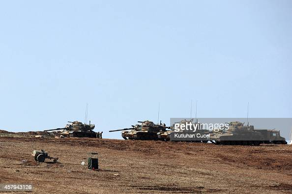 Turkish Army tanks hold their position on top of a hill October 27 2014 near Mursitpinar border crossing on the TurkishSyrian border Sanliurfa...