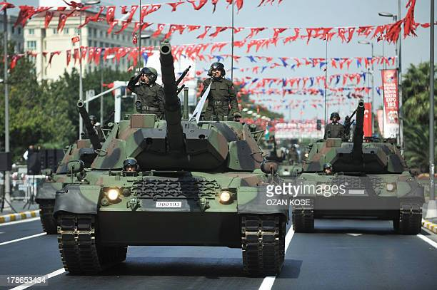 Turkish army tanks parade during Victory Day celebrations in Istanbul on August 30 2013 Turkey commemorates the anniversary of the day in 1922 that...