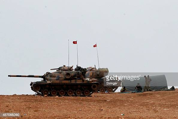 Turkish army tanks take position on top of a hill near Mursitpinar border crossing in the southeastern Turkish town of Suruc in Sanliurfa province...