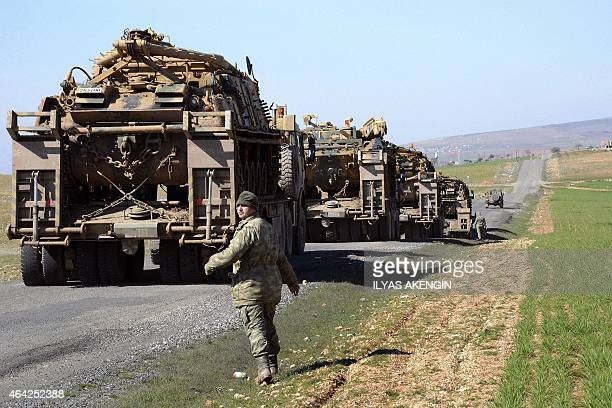 Turkish Army vehicles and tanks move near the Syrian border in Suruc on February 23 2015 as almost 600 Turkish troops pushed deep into Syria in an...