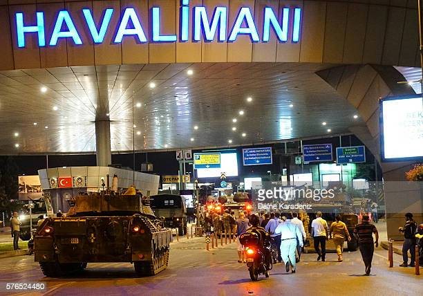 Turkish army's vehicles enter the Ataturk Airport on July 16 2016 in Istanbul Turkey Istanbul's bridges across the Bosphorus the strait separating...