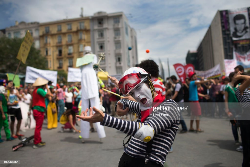 A Turkish art group preforms in support of protestors at Taksim Square onJune 5, 2013 in Istanbul, Turkey. The protests began initially over the fate of Taksim Gezi Park, one of the last significant green spaces in the center of the city. The heavy-handed viewed response of the police, Prime Minister Recep Tayyip Erdogan and his government's increasingly authoritarian agenda has broadened the rage of the clashes.
