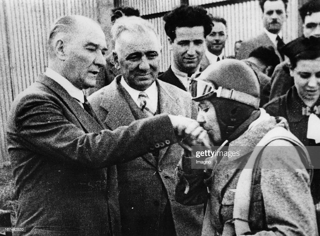 Turkish politician and the first President of the Republic of Turkey Mustafa Kemal Atatürk. The Turkish pilot Sabiha Goektschen kisses his hand. 1938. Photograph. (Photo by Imagno/Getty Images) Der türkische Politiker und erster Präsident der Republik Türkei Mustafa Kemal Atatürk. Die türkische Pilotin Sabiha Goektschen küsst seine Hand. 1938. Photographie.