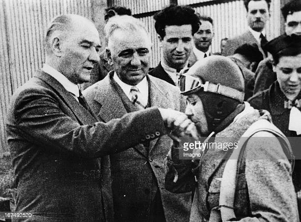 Turkish politician and the first President of the Republic of Turkey Mustafa Kemal Atatürk The Turkish pilot Sabiha Goektschen kisses his hand 1938...