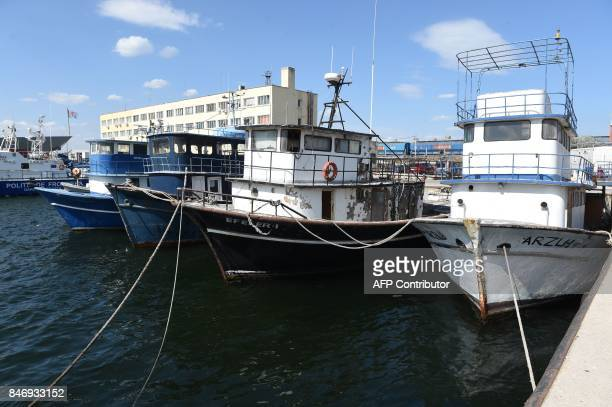 Turkish boats of wich some transported migrants over the Black Sea and were seized by Romanian border police are pictured in Constanta southeastern...