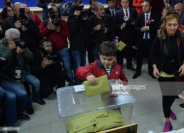 Turkish boy casts his mother's vote at a polling station during a general election on November 1 in Ankara Turkey Polls have opened in Turkey's...