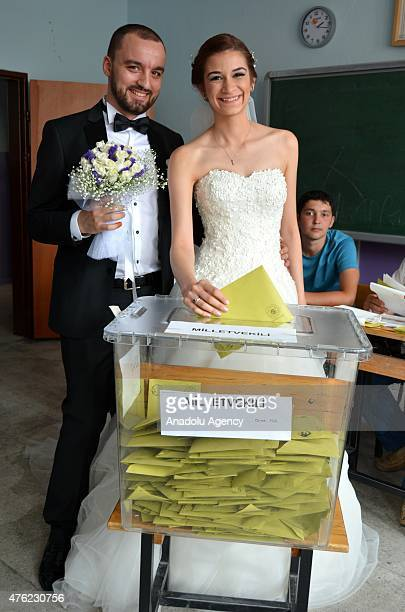 Turkish bride Yazgulu Isikli and her groom Bilgehan cast a ballot in the Turkish general election at a polling station in Aydin Turkey on June 07...