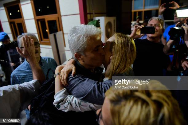 Turkish cartoonist Musa Kart of the Cumhuriyet hugs his wife after being freed from Silivri prison on July 28 2017 following a Turkish court order to...
