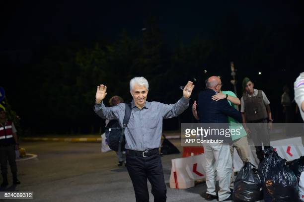Turkish cartoonist Musa Kart of the Cumhuriyet newspaper gestures after being freed from Silivri prison on July 28 2017 following a Turkish court...