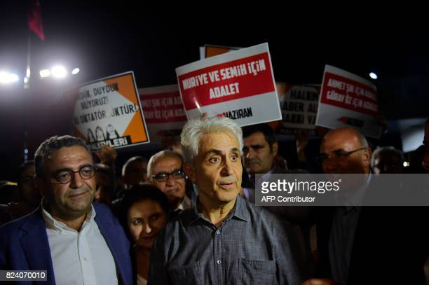 Turkish cartoonist Musa Kart of the Cumhuriyet newspaper reacts as he is welcomed by supporters after being freed from Silivri prison on July 28 2017...