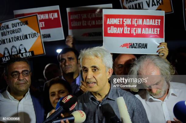 Turkish cartoonist Musa Kart of the Cumhuriyet newspaper speaks to the press as he is welcomed by supporters after being freed from Silivri prison on...