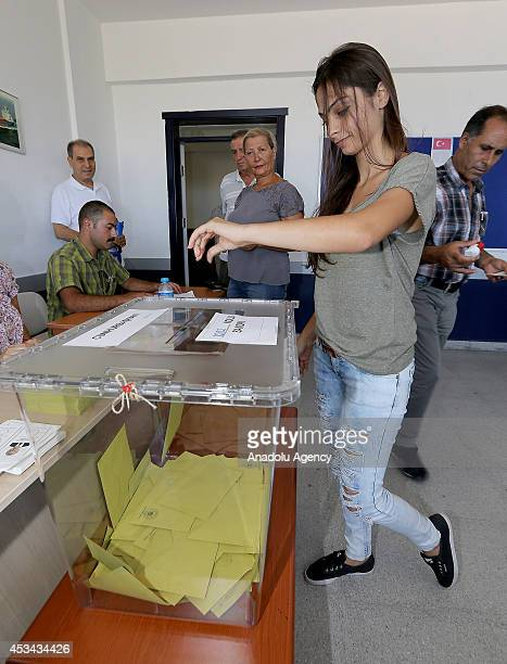 Turkish citizen casts her ballot in Turkish Presidential election in Cesme district of Izmir western city Turkey on August 10 2014 Voters of all ages...