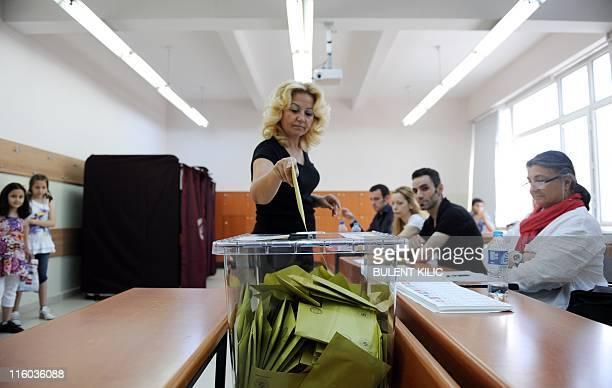 A Turkish citizen casts her vote in Istanbul on June 12 2011 during Turkey`s general election Turks went to the polls in parliamentary elections with...