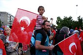Turkish citizen from Maasmechelen of Belgium hold flags as gather to protest the 'Parallel State/Gulenist Terrorist Organization's failed military...