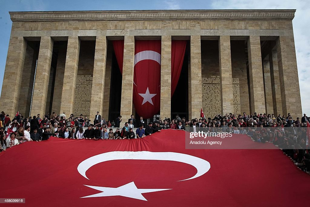 Turkish citizens hold a giant Turkish flag during their visit Ataturk's Anitkabir mausoleum within the Turkish Republic Day celebrations on the 91st...