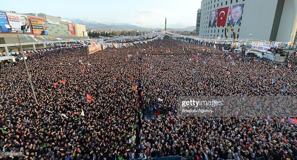 Turkish citizens listen as Prime Minister Recep Tayyip Erdogan (not pictured) speaks during a local election rally organized by the ruling Justice and Development Party (AKP) in Malatya, Turkey, on March 6, 2014.