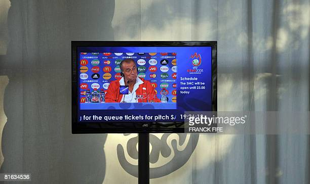 Turkish coach Fatih Terim is seen on tv screen while giving a press conference on June 19 at Ernst Happel Stadium in Vienna Turkey will play their...