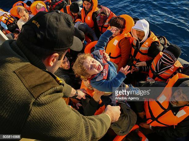 Turkish Coast Guard members help refugees who were trying to go to Greek Islands to get on a ship after being caught by the TCSG 'Guven' Ship...