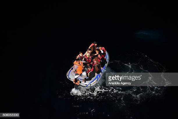 Turkish Coast Guard members intervene a boat carrying refugees who were trying to go to Greek Islands after being caught by the Turkish coast guards...