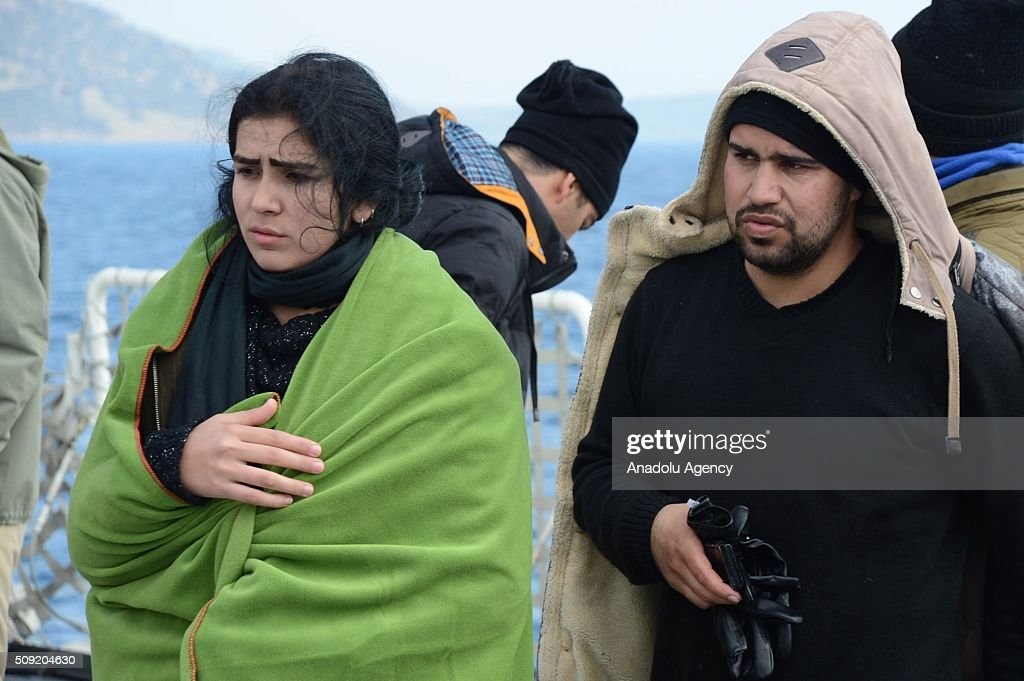 Turkish Coast Guard ship TCSG Umut (Hope) crew members rescue refugees on February 09, 2016 after a total of 54 refugees and asylum seekers were captured in the Aegean Sea, in shores of Canakkale province of Turkey, as they attempted to reach the nearby Greek islands.
