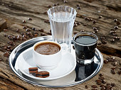 Traditional serving of Turkish coffee with water and liqueur