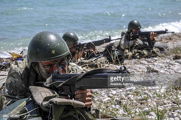 Turkish commandos are seen during an evacuation practice as they participate in a naval surface warfare exercise at the Egirdir Commando Training...