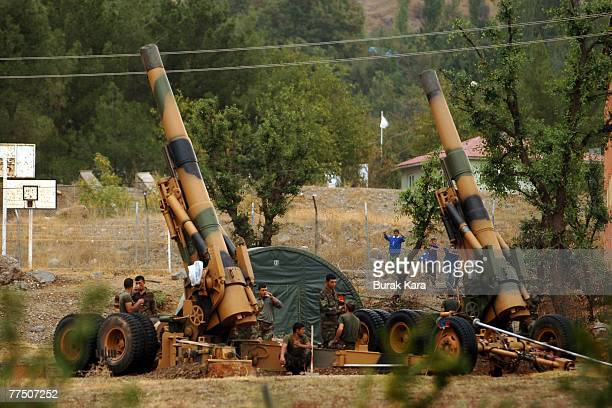 Turkish commandos take a break beside artillery cannons aimed towards northern Iraq at the Senoba Military base 4km from Iraq on October 26 2007 in...
