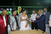 Turkish couple take their marriage license following a mass wedding ceremony organized by the local government and nonprofit organization Nehir...