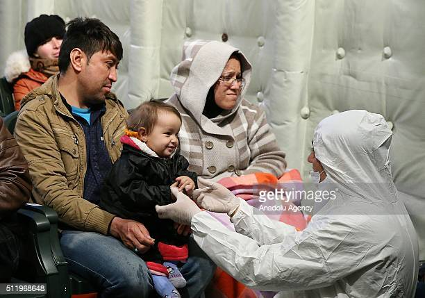 Turkish crew member takes care with 1yearold Afghan baby Seher as she is being hosted with his parents at a Turkish Coast Guard ship following a...