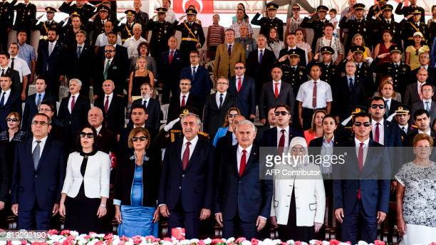 Turkish Cypriot leader Mustafa Akinci accompanied by Turkish Prime Minister Binali Yildirim attend an army parade in the northern part of Nicosia the...