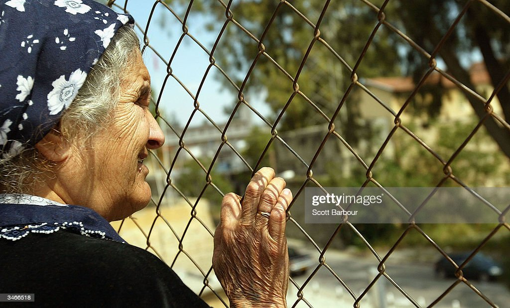 Turkish Cypriot woman looks over the UN Buffer Zone into the Greek part of the divided city of Nicosia from the Turkish side April 25 2004 in Nicosia...