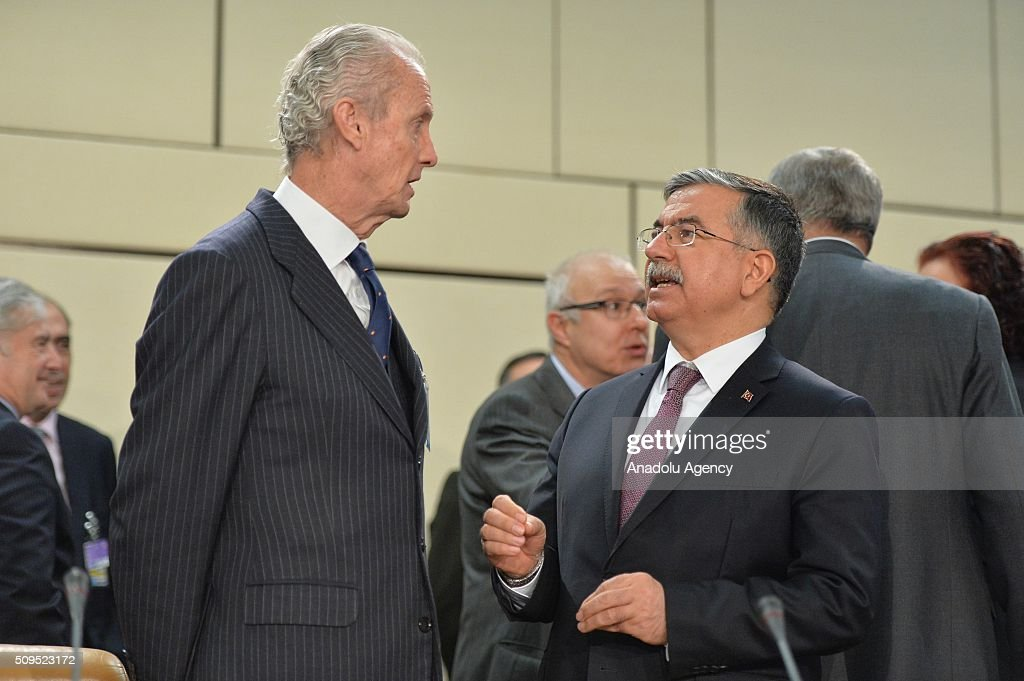 Turkish Defence Minister Ismet Yilmaz (R) and Spanish Defense Minister Pedro Morenes Eulate (L) attend the NATO Defence Ministers Meeting which is being held in Brussels, Belgium on February 11, 2016.