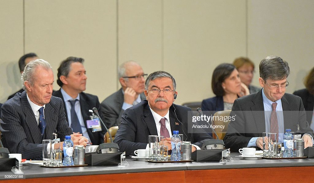 Turkish Defence Minister Ismet Yilmaz (C) and Spanish Defense Minister Pedro Morenes Eulate (L) attend the NATO Defence Ministers Meeting which is being held in Brussels, Belgium on February 11, 2016.