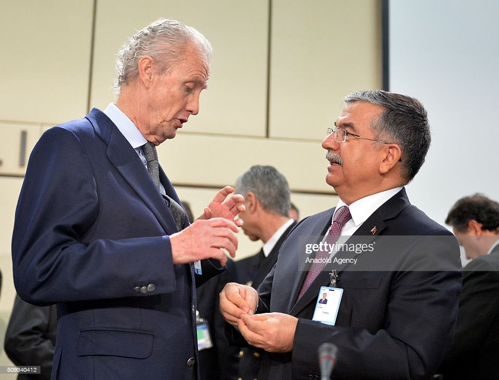 Turkish Defense Minister Ismet Yilmaz (R) and Spanish Defense Minister Pedro Morenes Eulate (L) speak to each other prior to the start of a NATO Defence Ministers meeting at the NATO headquarter in Brussels, Belgium on February 10, 2016.