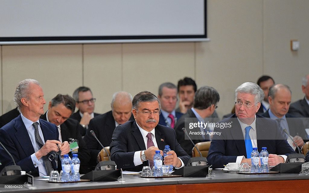 Turkish Defense Minister Ismet Yilmaz (C), Spanish Defense Minister Pedro Morenes Eulate (L) and British Defence minister Michael Fallon (R) attend the NATO Defence Ministers meeting at the NATO headquarter in Brussels, Belgium on February 10, 2016.